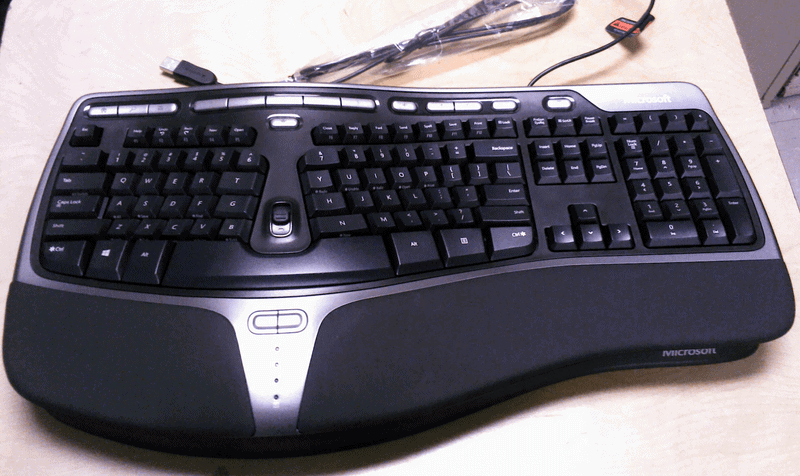 A black computer mouse and keyboardDescription automatically generated