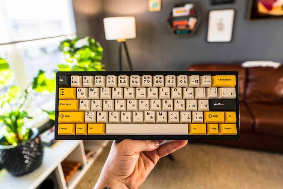 Customized keyboard with a mix of yellow and white switches.