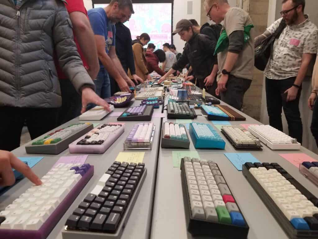Different people and keyboards at a mechanical keyboard meet up