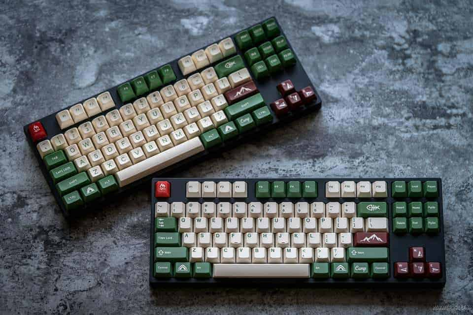 two mechanical keyboards on a counter