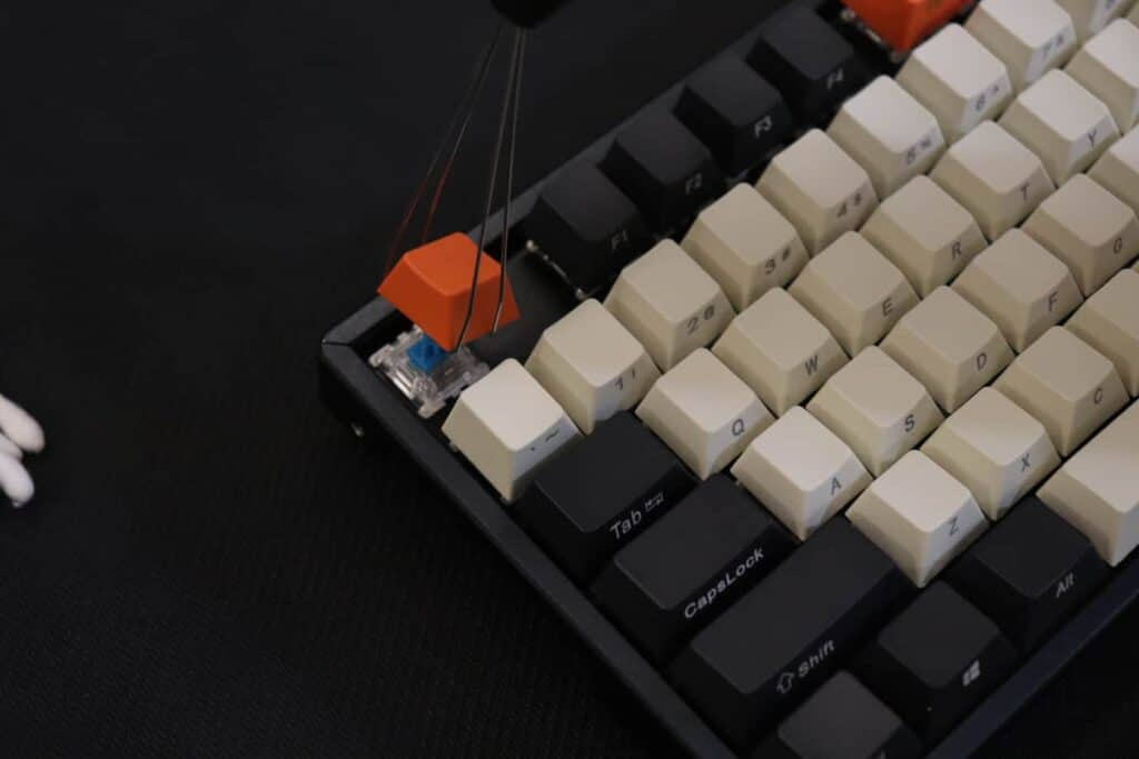 keycap being removed from mechanical keyboard