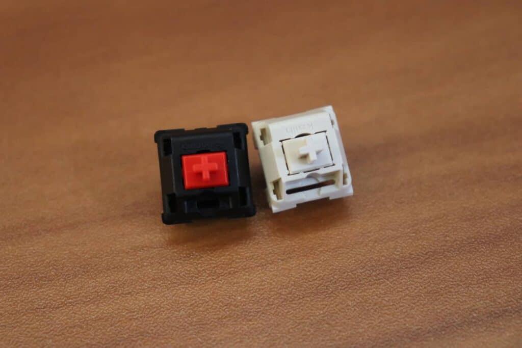 Cherry MX Red switch next to Novelkey cream switch