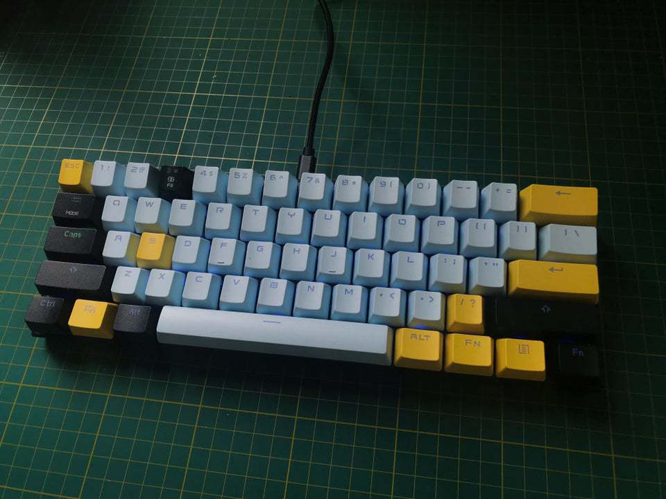 Motospeed CK62 on table with multi-color keycaps