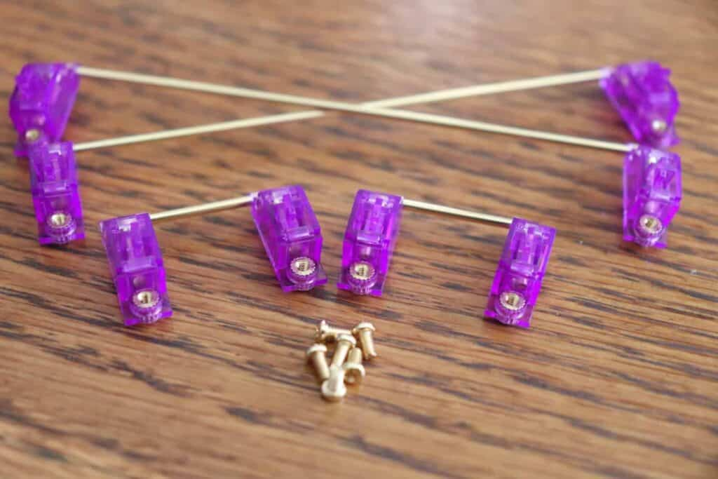 Durock stabilizers with a purple stem and gold stabilizer bar