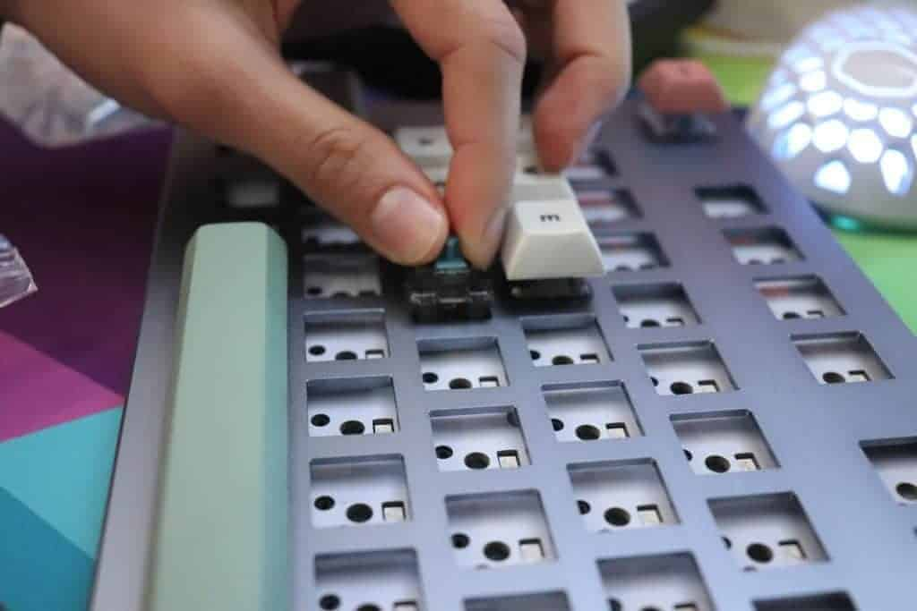 switches being inserted into mechanical keyboard