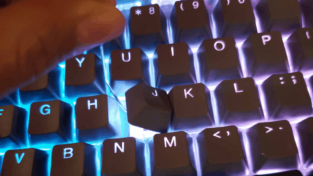 taking keycaps of a mechanical keyboard using a DIY keycap puller