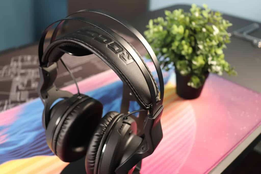 Roccat ELO X Stereo on a headphone stand with plant in the background