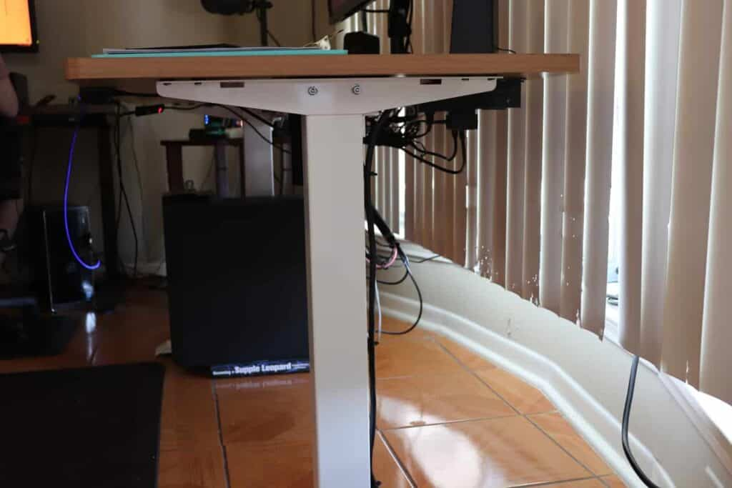 A standing desk with a PC setup.