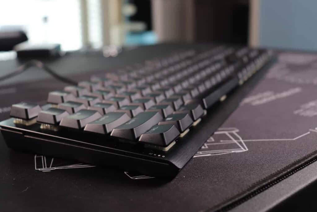 Angled view of Corsair K60 low profile mechanical keyboard sitting on a deskmat