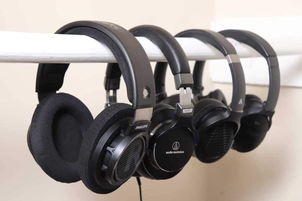 Variety of headphones hanging next to each other