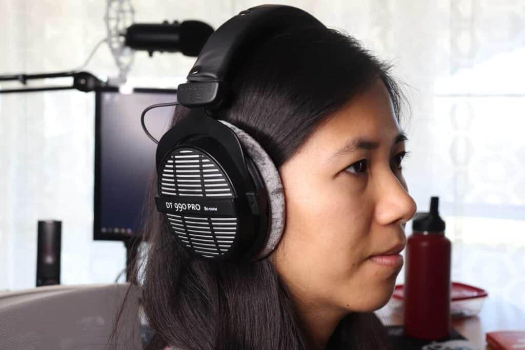 Someone wearing open-back headphones in office