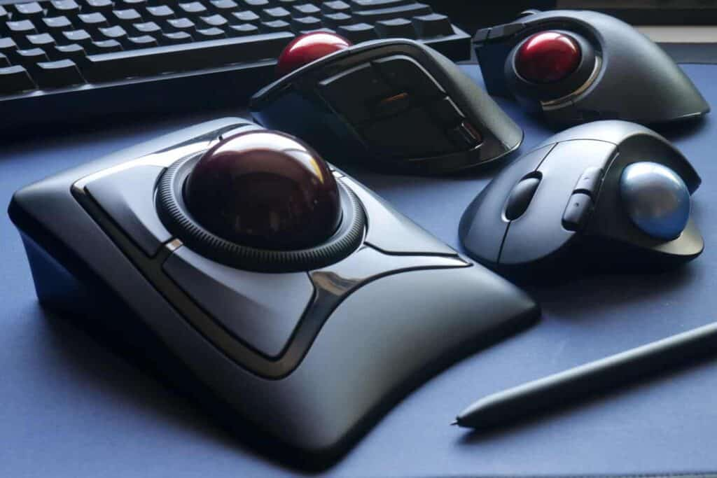 A variety of trackball mice on a desk