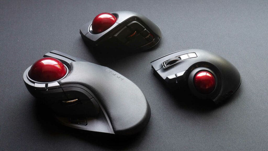 Variety of Elecom trackballs next to each other on a desk