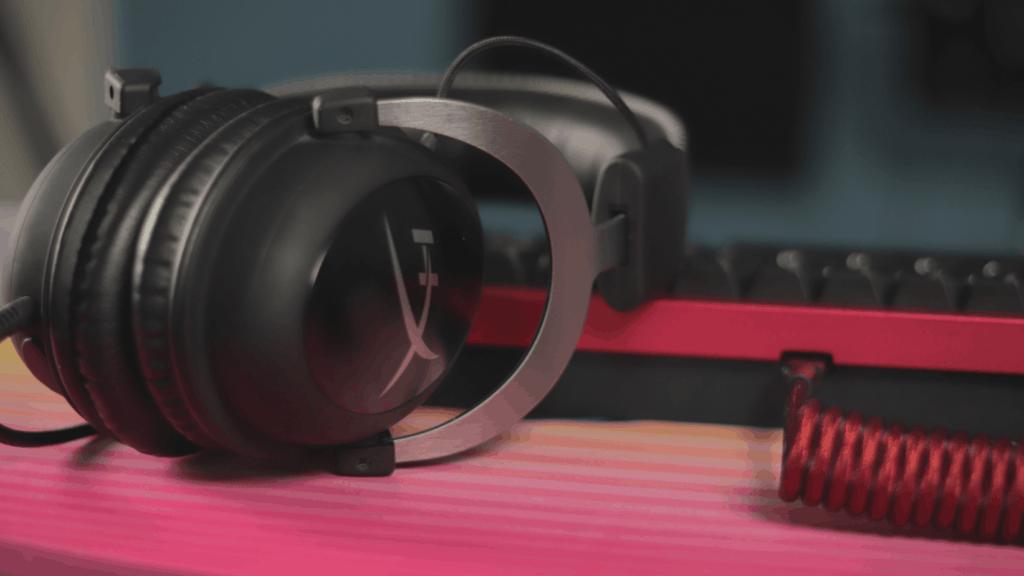 gaming headset resting on mechanical keyboard