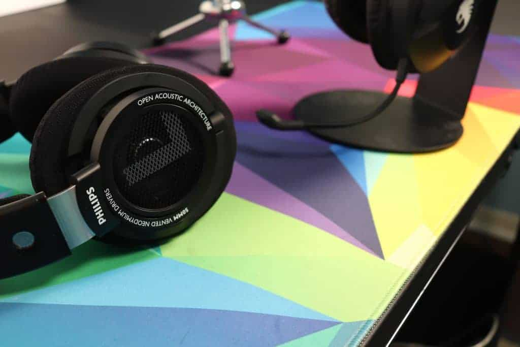 headphones sitting on a desk next to a headset